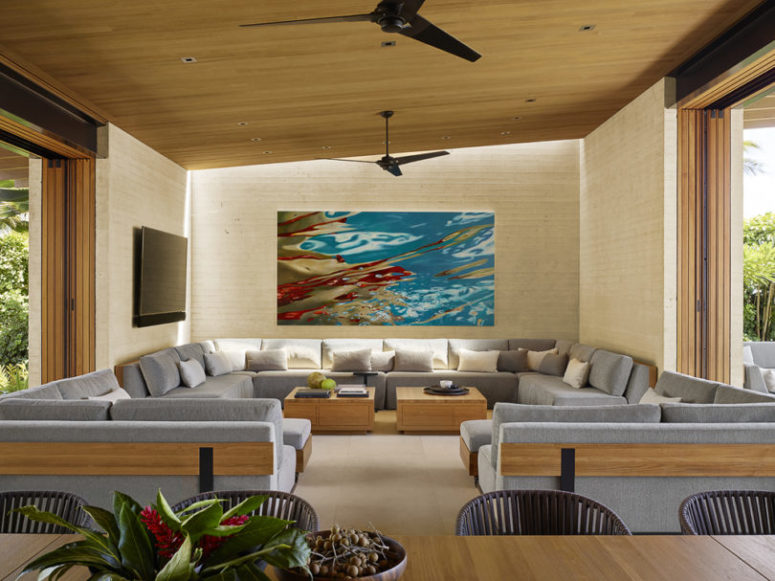 The living room features a large corner sofa and two smaller corner ones for creating a large conversation pit