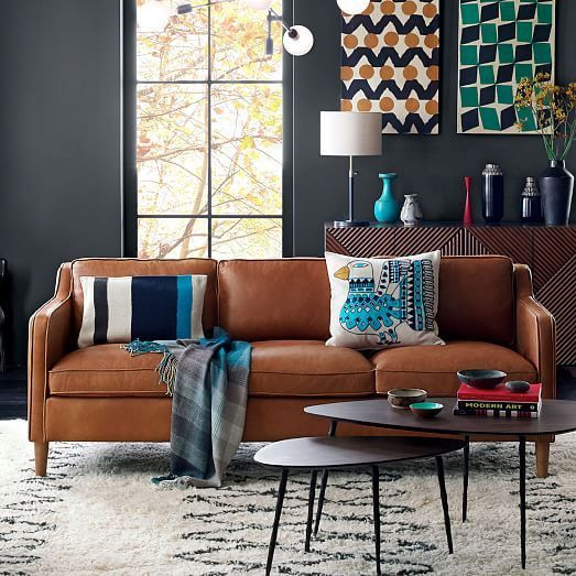 a Stockholm sofa in tan leather adds texture and comfort to this eye-catchy space