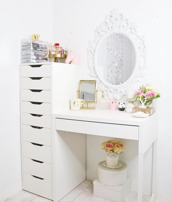 a chic makeup nook with several mirrors and a large drawer unit used for makeup storage