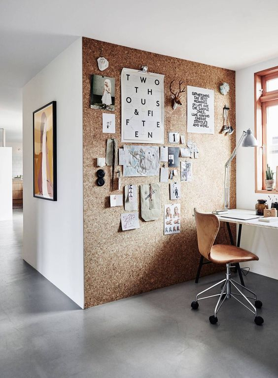 a cork wall is a great and creative idea for any workspace, and its softness adds warmth to the space