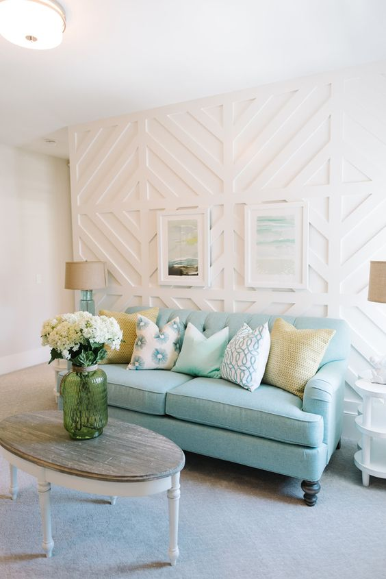 a cottage-style space with a wwhite paneled wall that catches an eye