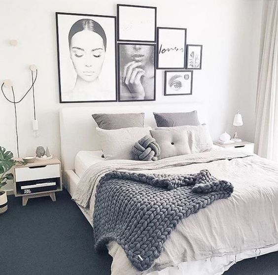 a gorgeous gallery wall in black and white with a girlish feel