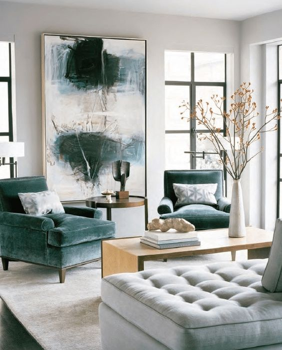 the oversized artwork matches the grey green chair upholstery
