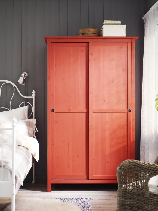 Hemnes with sliding doors painted red looks rustic yet colorful and makes a statement