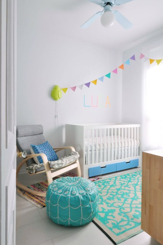 IKEA Stuva cot with bold blue drawers for a colorful nursery