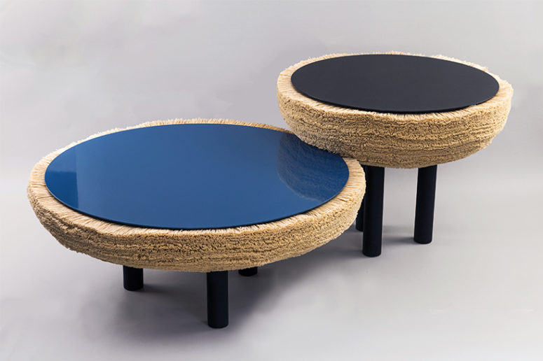 The coffee tables are done in black and blue and are also covered with fur