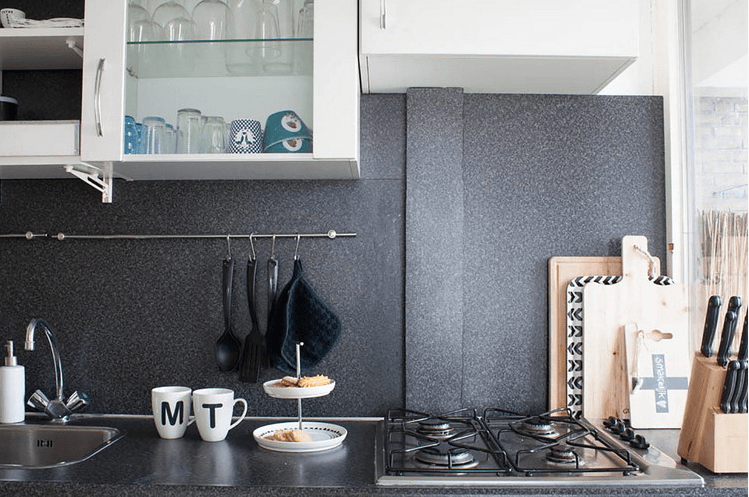 The kitchen is done in graphite and white, and is enlivened with patterns