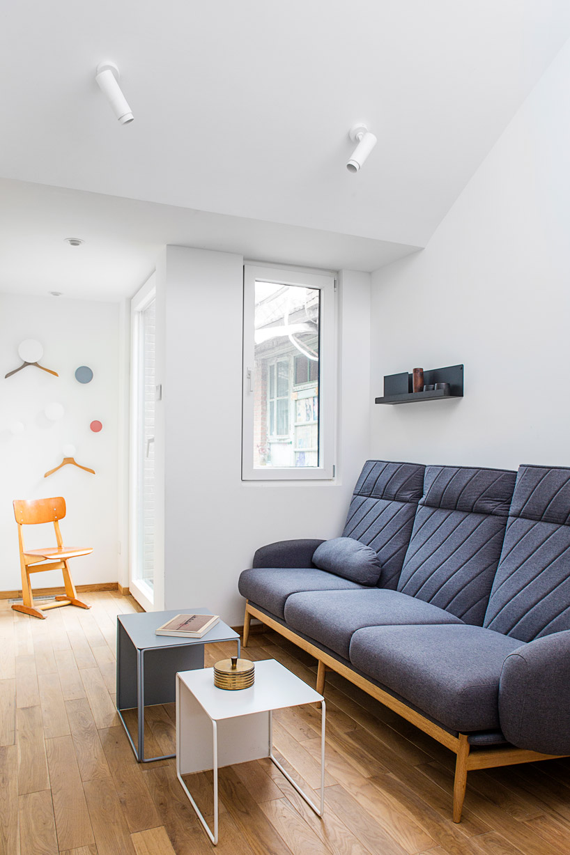 The living room and bedroom in one features simple modern furniture and high quality windows to keep the air clean