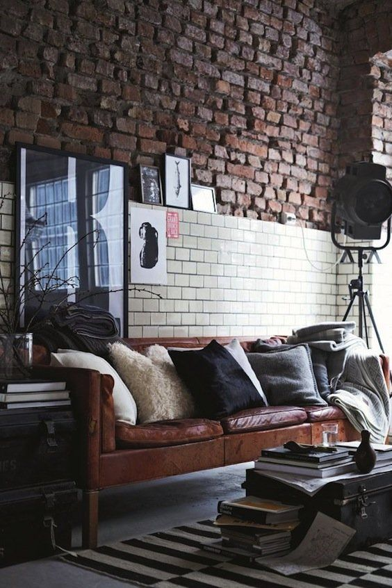 a Stockholm sofa in brown leather looks chic in an industrial space with a vintage feel