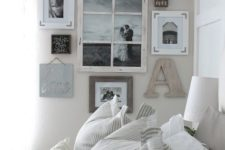 05 a gallery wall with personal wedding photos, monograms and signs