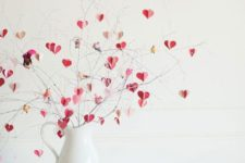 05 a modern Valentine's Day centerpiece of a white jug and pink, blush and gold hearts on branches
