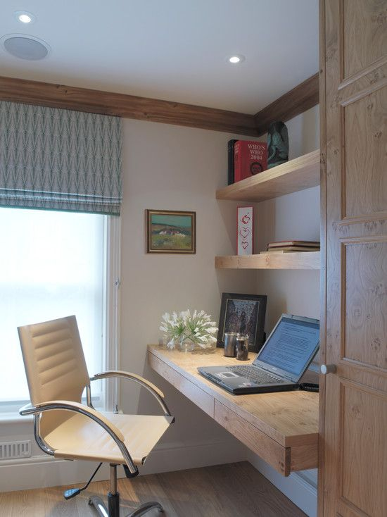 a small yet comfy working nook with floating shelves and a desk with drawers made of light-colored wood