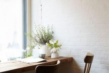 05 a wooden windowsill and chairs make an industrial space cozier