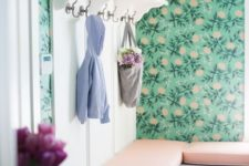 05 bold green wallpaper with a floral print and matching cushions on the benches