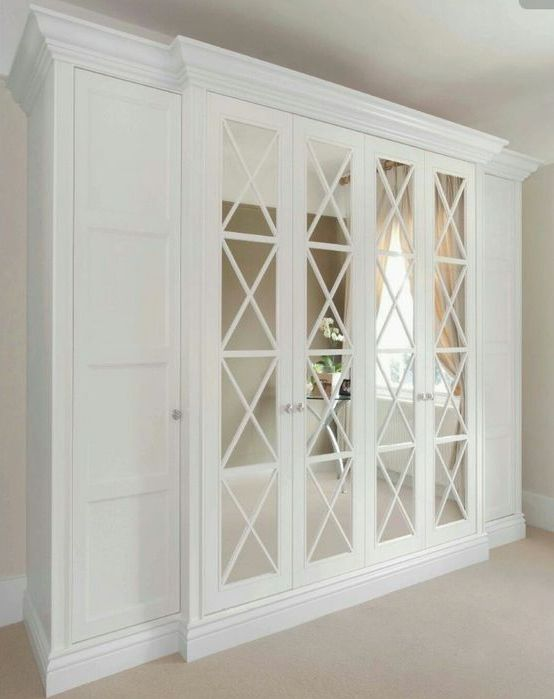 classic mirrored doors with criss cross frames make the wardrobes stand out