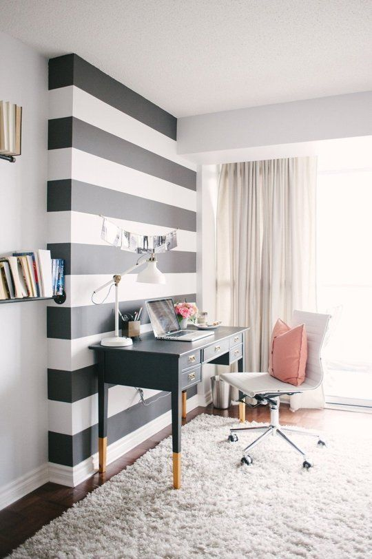 the home office accentuated with a black and white striped wall