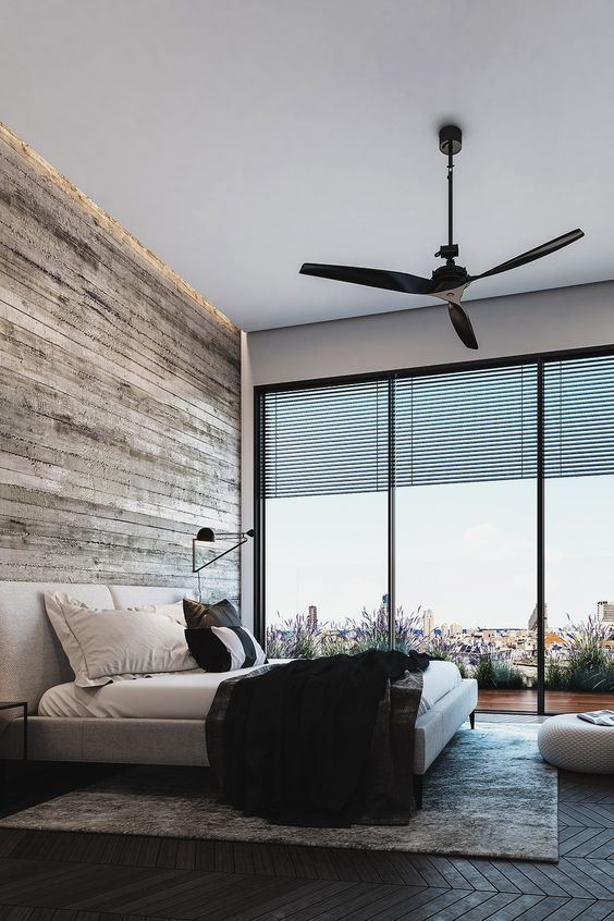 this rustic masculine space features a glazed wall with views of the city
