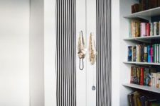 06 Aneboda wardrobe with black and white striped doors for an elegant feel