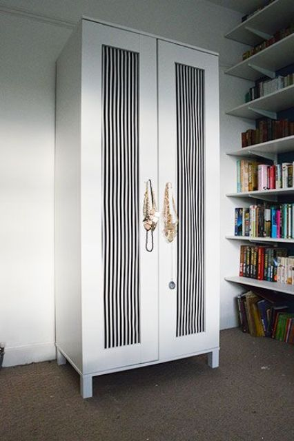Aneboda wardrobe with black and white striped doors for an elegant feel