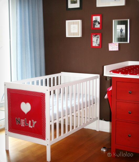 IKEA Sundvik cot with a colorful fabric accent with the baby's name