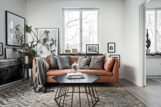 a Scandinavian apartment in grey, black and white with a tan leather Stockholm sofa for a warm touch