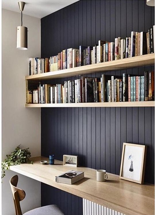 office floating shelves. A Black Wall And Light-colored Wooden Floating Shelves Plus Desk Below For Reading Office O