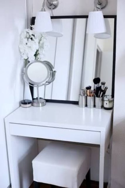 a small and stylish makeup nook done with a Micke desk, a comfy stool and some mirrors