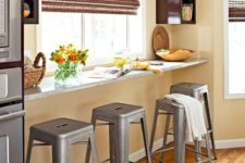 06 a windowsill breakfast bar with industrial stools and some storage shelves on both sides