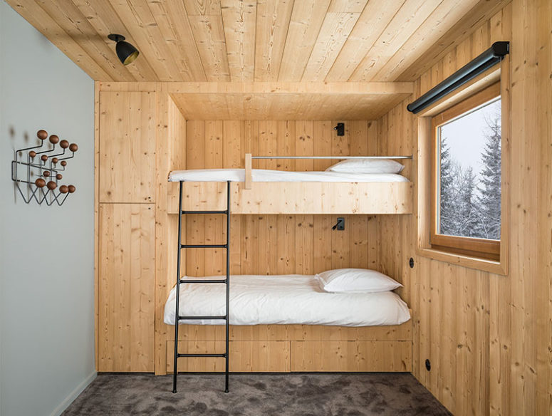 The guest or kids' space is done with a built-in bunk bed