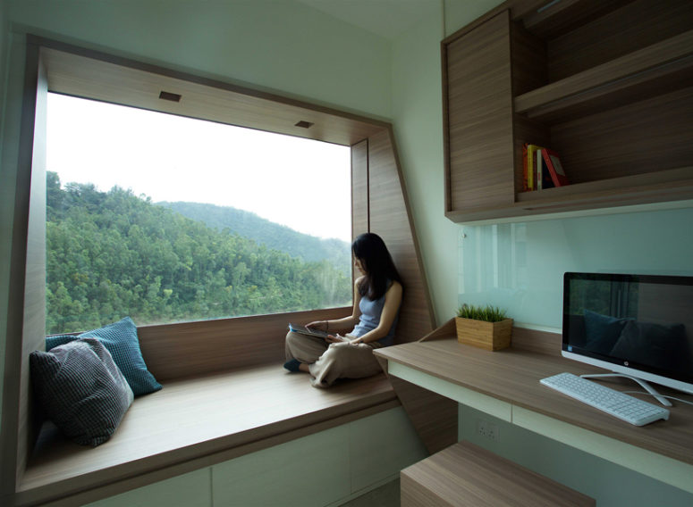 The guest space features another window with a bench and a working space