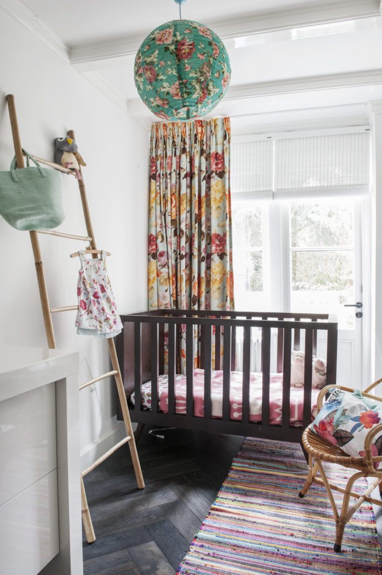 The kid's space is done with floral textiles, a striped rug and looks very lively and colorful - exactly what a small girl needs