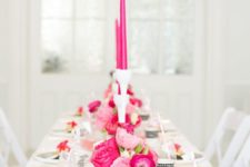 07 a black and white table setting with pink and hot pink florals and candles