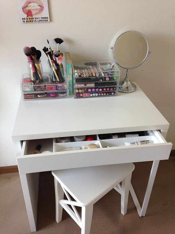 a simple makeup zone with a Micke desk and a stool, all the makeup in an acrylic unit