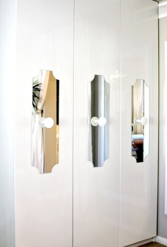 cutout mirror touches with white knobs add interest to a Pax wardrobe