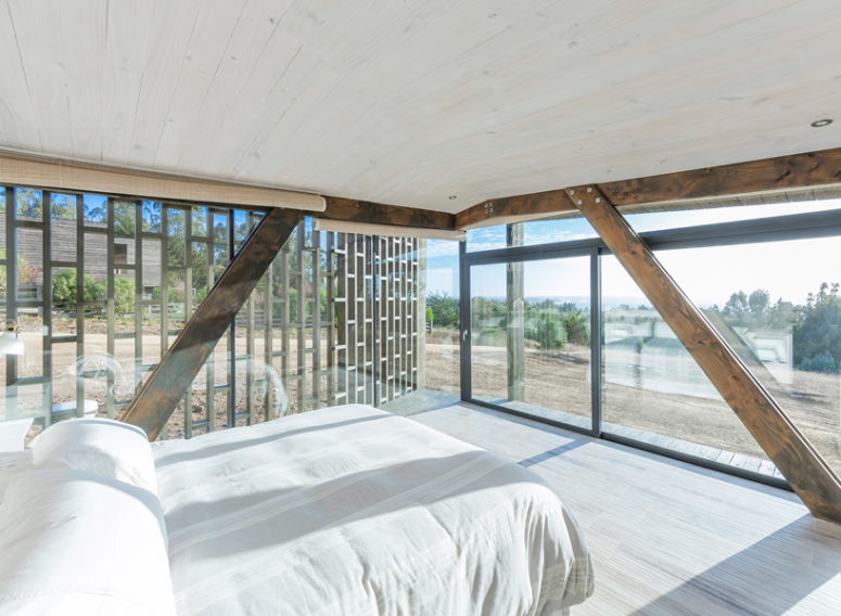 The bedroom features only a bed, some bedside tables and lamps, and the views are amazing