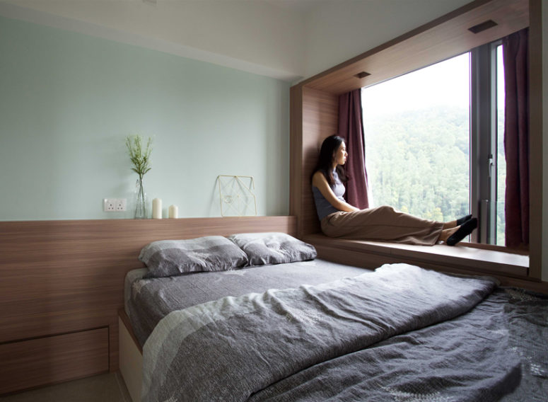 The master bedroom is done with a platform bed and another window with a view