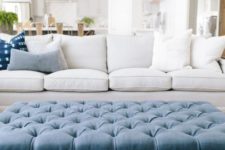 08 a large tufted blue ottoman hints that it's a beach space