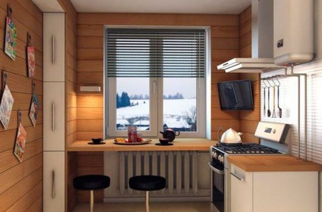 a small kitchen clad with wood and a windowsill bar with modern stools and a view