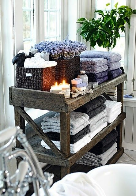 add a wooden stand with towels, candles, soaps and flowers for a stylish feel