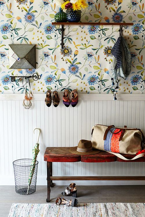 blue floral print wallpaper and wainscoting gives the entryway a cozy farmhouse feel