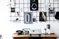 09 a black grid hung over the desk is a great piece to use as a pinboard