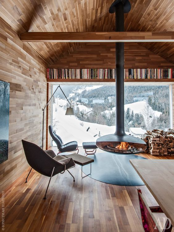 a chalet with gorgeous mountain views and a suspended hearth