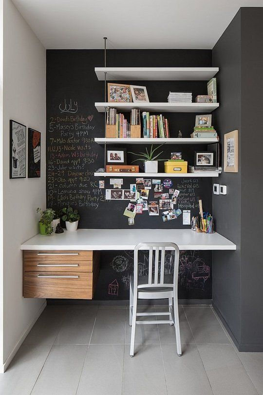 a chalkboard nook with floating shelves and a floating desk with several drawers for a lightweight look