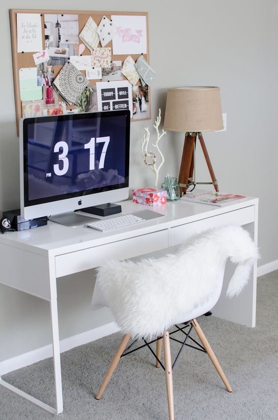 a comfy workspace with a Micke desk, a table lamp and a pinboard, a comfy chair is a perfect fit