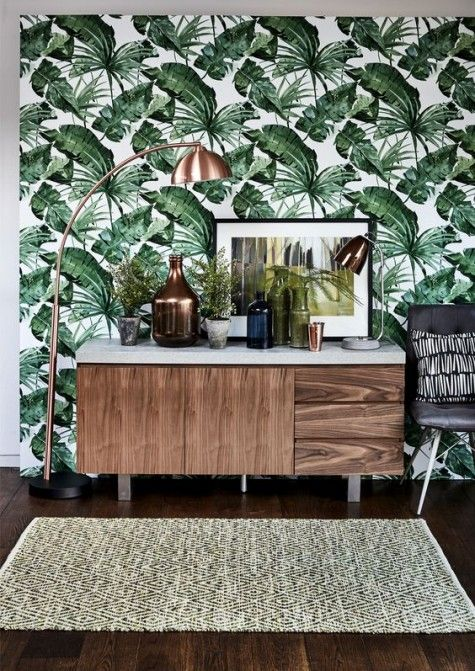 a tropical print wallpaper wall is a classic and bold solution for any living room