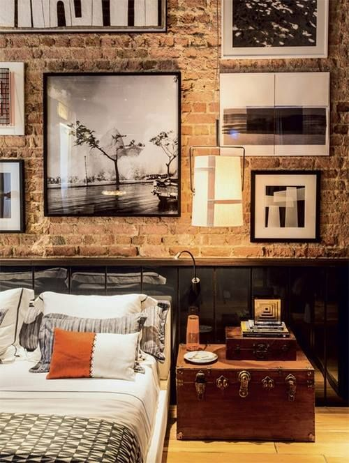 an industrial masculine space with a wall covered with various artworks completely