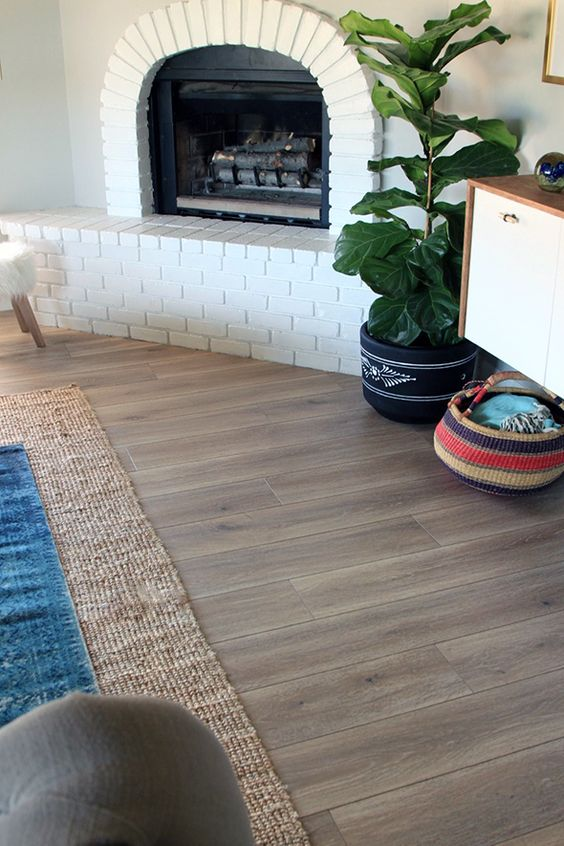 laminate is a great option for a living or dining room as it's easy to maintain and is stain resistant