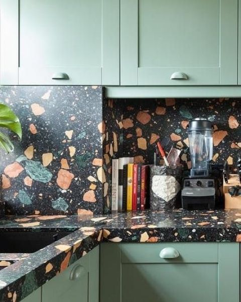 rock a bold terrazzo backsplash and countertops that match the cabinets somehow