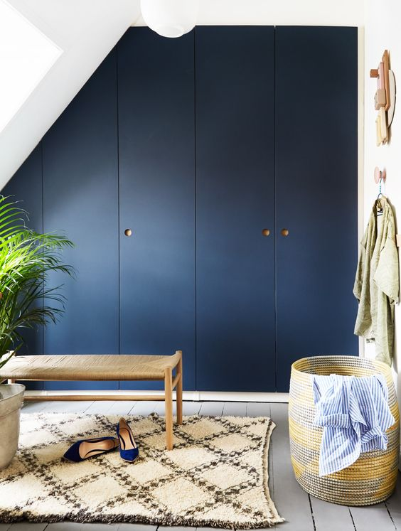 very chic Pax hack for an attic space, with a smokey blue shade and natural oak handles