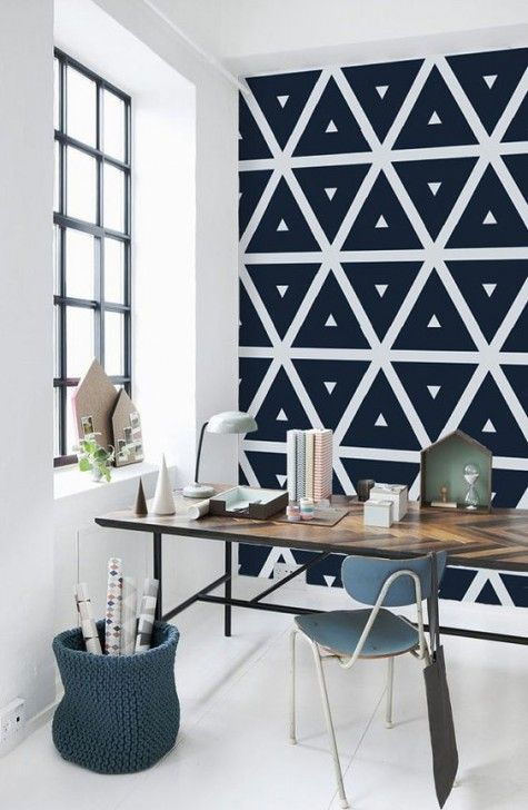 a geometric black and white wallpaper wall is a chic idea for a Scandinavian space